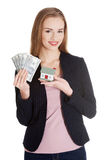 Beautiful caucasian business woman holding dollar curency and mo Stock Photo