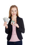 Beautiful caucasian business woman holding dollar curency and mo Royalty Free Stock Image