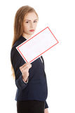 Beautiful caucasian business woman is holding empty white board. Stock Images