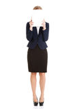 Beautiful caucasian business woman holding empty white paper. Stock Photography