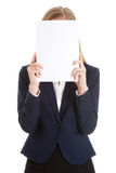 Beautiful caucasian business woman holding empty white paper. Royalty Free Stock Photos