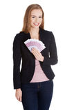 Beautiful caucasian business woman holding euro currency. Stock Images
