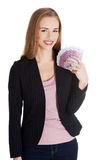 Beautiful caucasian business woman holding euro currency. Stock Photos
