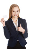 Beautiful caucasian business woman holding personal card. Stock Photo