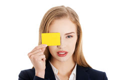 Beautiful caucasian business woman holding yellow empty personal Royalty Free Stock Photos