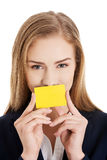Beautiful caucasian business woman holding yellow empty personal Stock Photography