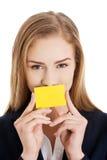 Beautiful caucasian business woman holding yellow empty personal Stock Photography