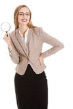 Beautiful caucasian business woman with magnifying glass. Stock Photography