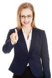 Beautiful caucasian business woman is pushing button on empty sp Stock Photo