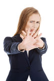 Beautiful caucasian business woman shows rejection and screams. Isolated on white Stock Photos