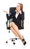 Beautiful caucasian business woman sitting on a chair and advert Stock Image