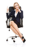 Beautiful caucasian business woman sitting on a chair and advert Royalty Free Stock Image