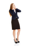 Beautiful caucasian business woman is touching her neck. Royalty Free Stock Photo