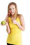 Beautiful caucasian casual slim woman drinking juice from an app Stock Photo