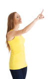 Beautiful caucasian casual woman pointing up on copy space. Stock Images