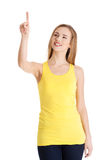 Beautiful caucasian casual woman pointing up on copy space. Royalty Free Stock Image