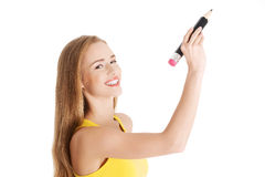 Beautiful caucasian casual woman is writing on copy space. stock images