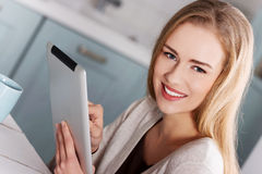 Beautiful caucasian causal woman with tablet. Royalty Free Stock Image