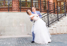 Beautiful caucasian couple just married and dancing their first dance Stock Photos