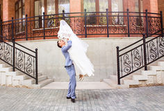Beautiful caucasian couple just married and dancing their first dance Royalty Free Stock Photos