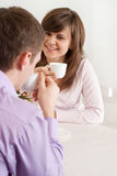Beautiful Caucasian couple sitting Royalty Free Stock Images