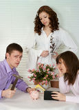Beautiful Caucasian couple sitting at a table Royalty Free Stock Photo