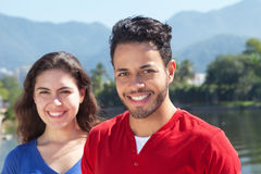 Beautiful caucasian couple in vacation looking at camera Royalty Free Stock Photography