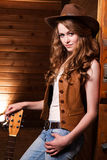 Beautiful caucasian cowgirl with guitar Royalty Free Stock Photos