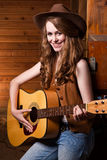 Beautiful caucasian cowgirl with guitar Stock Photos
