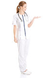 Beautiful caucasian doctor or nurse is presenting an abstract sp Stock Images