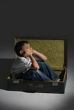 Beautiful Caucasian dream boy sitting i Royalty Free Stock Photos