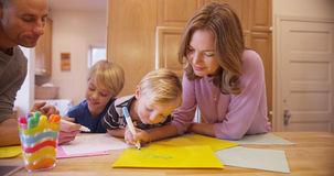 Beautiful caucasian family drawing for her young child stock photography
