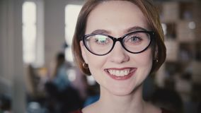 Beautiful Caucasian female leader smiling at camera close-up. Portrait of happy woman manager in glasses posing 4K. Beautiful Caucasian female leader smiling at stock video