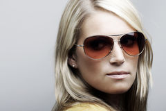 Beautiful Caucasian female model in sunglasses Royalty Free Stock Photos