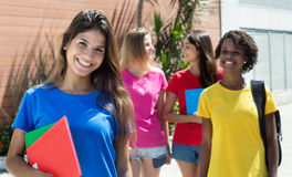 Beautiful caucasian female student in blue shirt with other international students Royalty Free Stock Photography