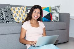 Beautiful caucasian female student with computer Royalty Free Stock Photos