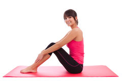 Beautiful caucasian fitness woman stretching Royalty Free Stock Photos