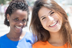 Beautiful caucasian girl with african girlfriend in the city Stock Photo