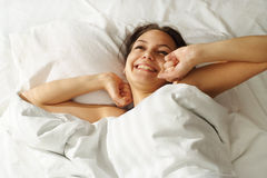 A beautiful caucasian girl in bed Royalty Free Stock Photos
