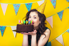 Beautiful caucasian girl blowing candles on her cake. Celebration and party. Royalty Free Stock Photos