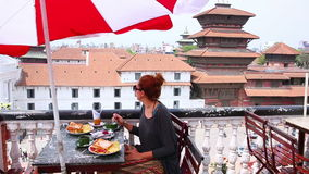 Beautiful Caucasian girl eating breakfast, lunch at rooftop, Kathmandu, Nepal, Stock Photos