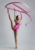 Beautiful Caucasian girl gymnast with a ribbon Stock Images