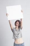 Beautiful caucasian girl holding a blank poster for text or ad. Stock Images