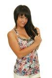 Beautiful caucasian girl holding her hair Royalty Free Stock Image