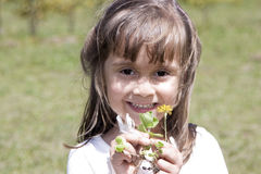 Beautiful caucasian girl playing with a flower Stock Photo