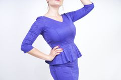 Beautiful caucasian girl with short hair and plus size body dressed in blue medium length dress in business style with peplum at t stock photo