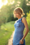 Beautiful caucasian girl is standing in the park Stock Photo