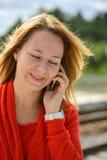 Beautiful caucasian girl talking to phone Royalty Free Stock Photos