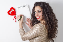 Beautiful Caucasian girl writing love letter Stock Images