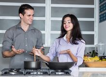 Beautiful caucasian love couple cooking at kitchen Stock Photography